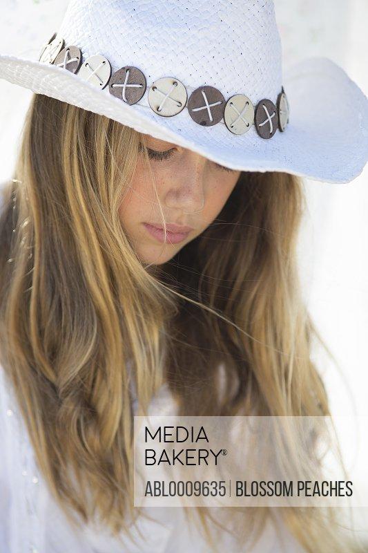 Teenage Girl Wearing Cowboy Hat, Close-up View