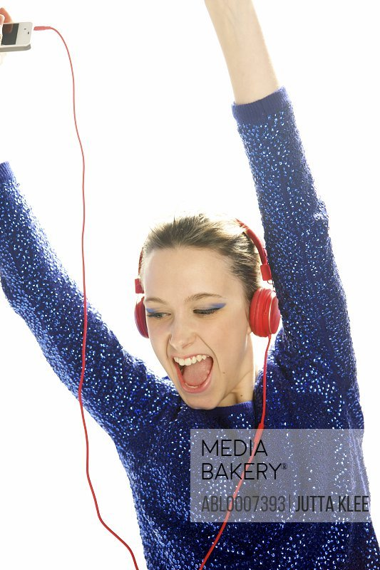 Teenage Girl with Headphones Dancing