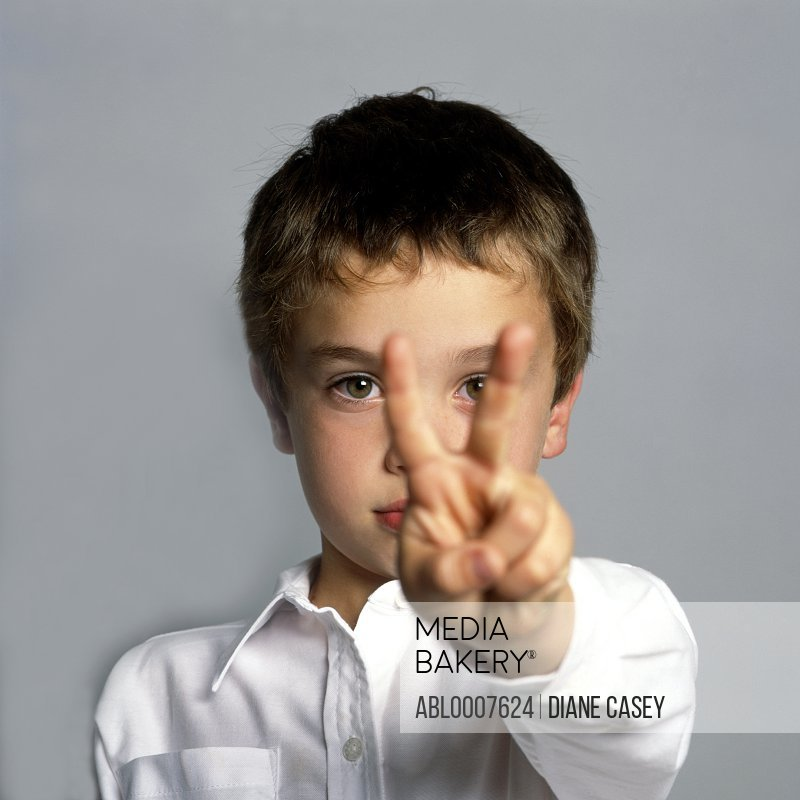 Boy Making Peace Sign