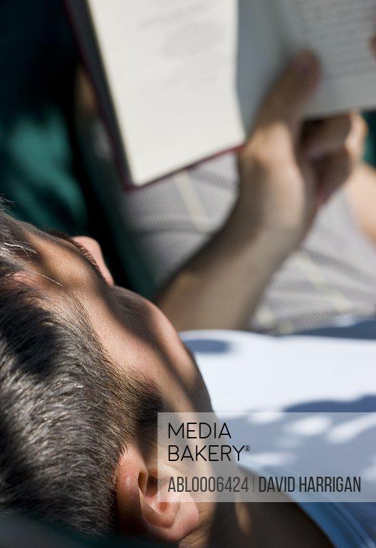 Man Reading Book on Hammock