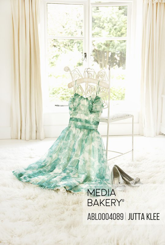 Dress Hanging on Chair with Shoes