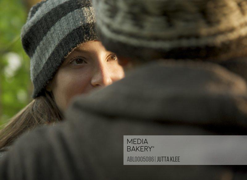 Close up of a young woman facing young man