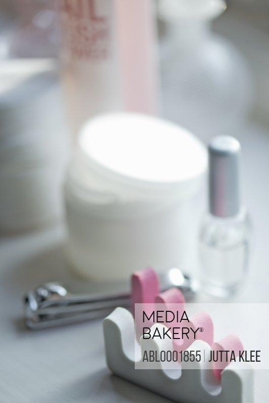Close up of toe separators and pedicure cosmetics