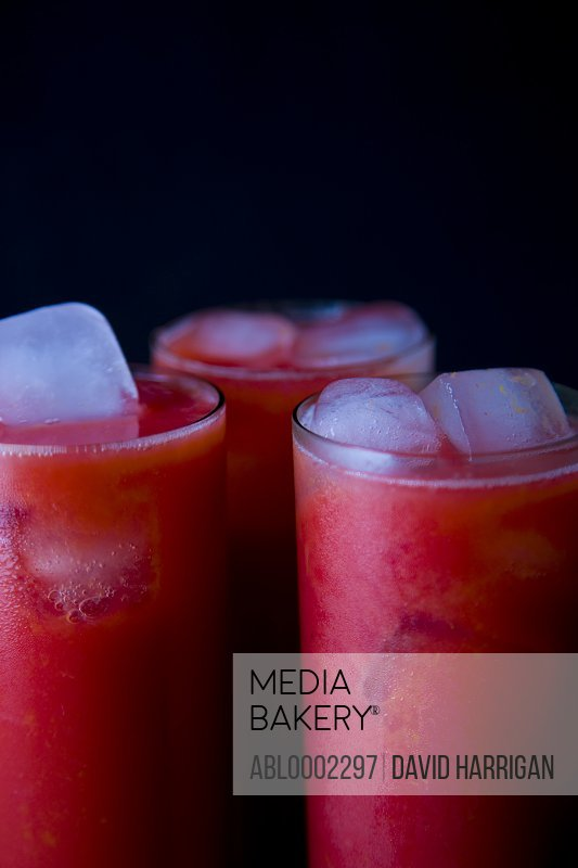Three Glasses of Raspberry Juice with Ice