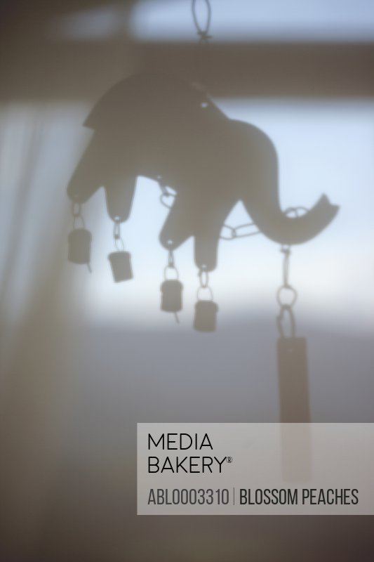 Silhouette of Elephant Shape Wind Chime, Close-up View