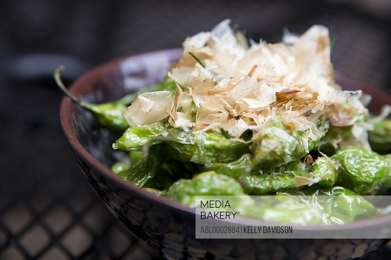 Bowl of Spinach Salad with Cheese Shavings