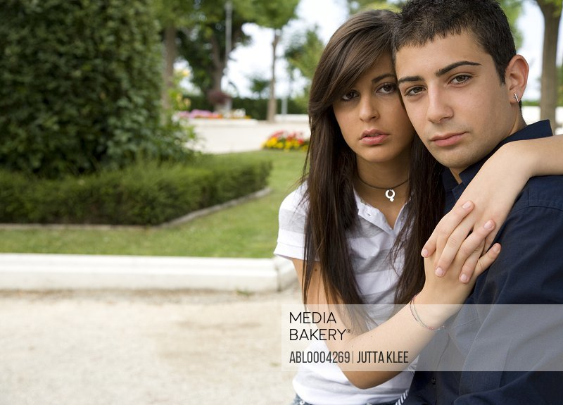 Portrait of young couple posing