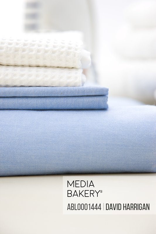 Close up of a stack of bed linen
