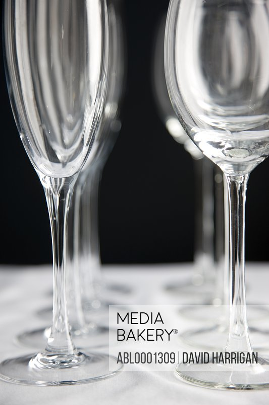 Close up of empty wine glasses lined up on a table