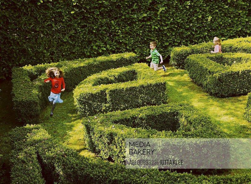 Children Running in Garden Maze