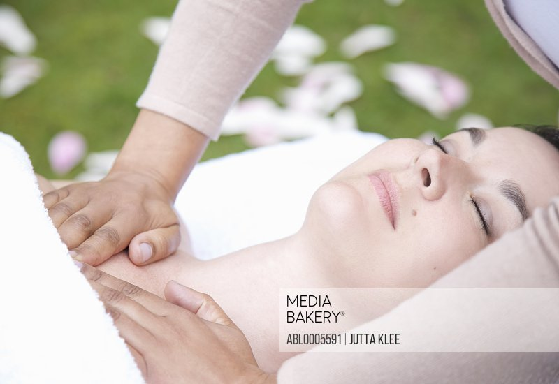 Close up of a woman receiving a chest massage outdoor