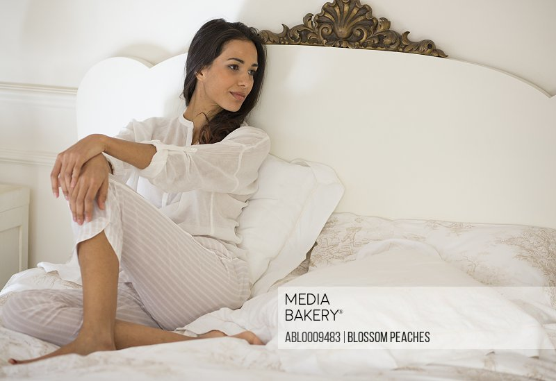 Woman Relaxing in Bed