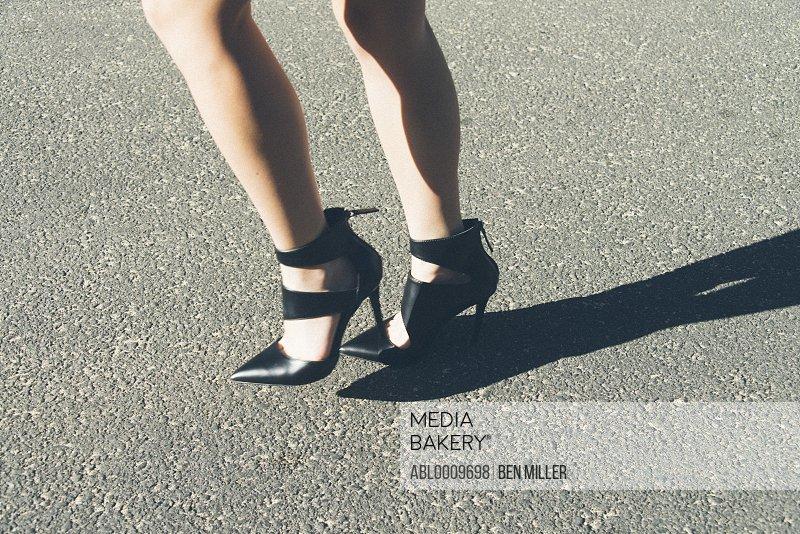 Woman Wearing High Heels Walking, Low Section