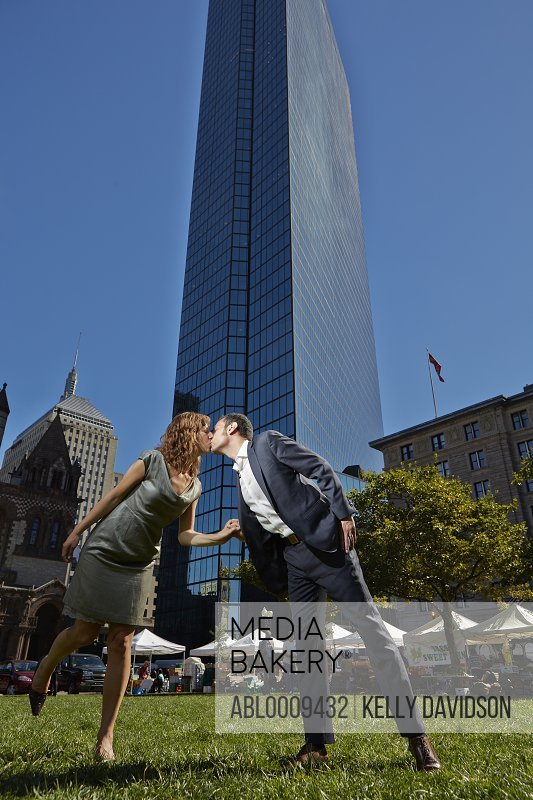 Couple Kissing in front of John Hancock Tower, Copley Square, Boston, USA
