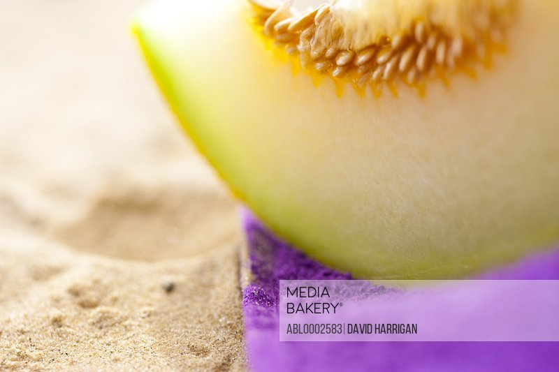 Melon Slice on Beach Towel, Close up view