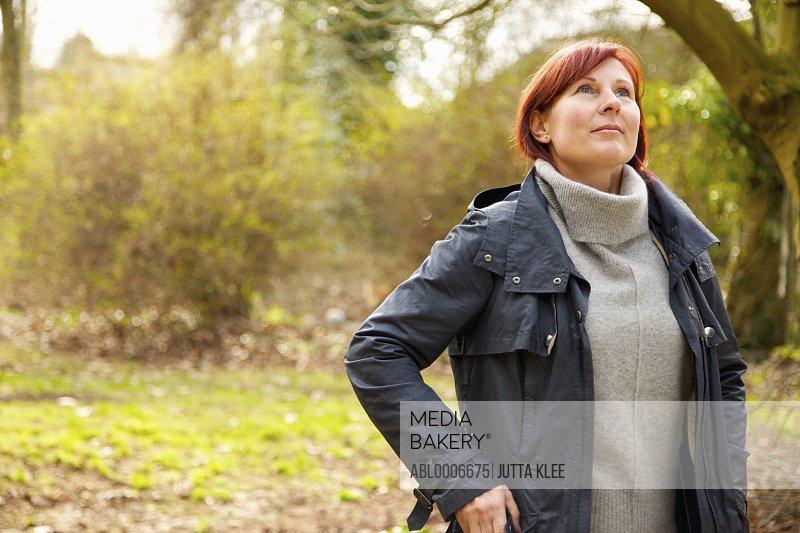 Woman Standing in Woodlands