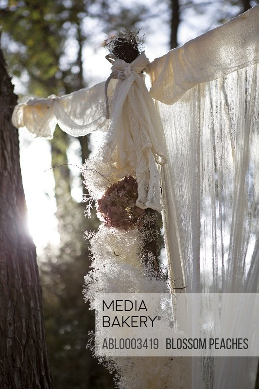 Draped Cloth and Flower Garland Decorations at Outdoor Wedding Ceremony