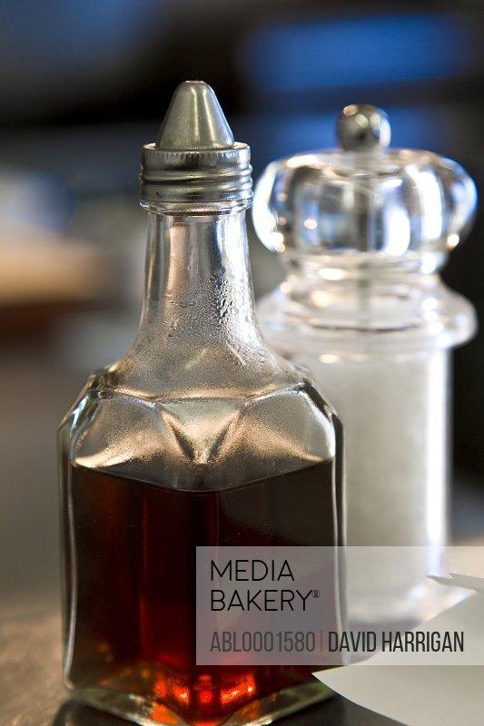 Dispenser of vinegar and a salt shaker