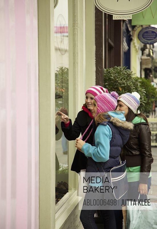 Teenage Girls Looking in Shop Window