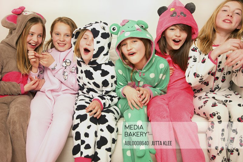 Group of Smiling Girls Wearing Animal Costumes