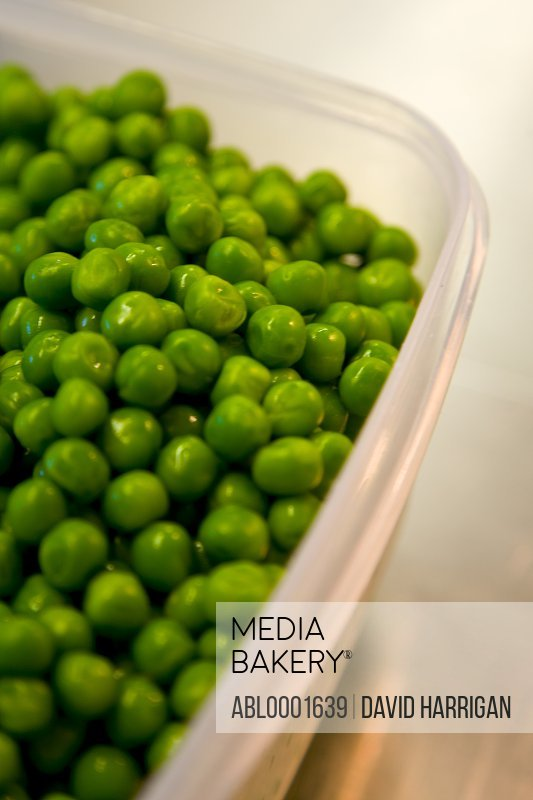 Extreme close up of a container full of peas