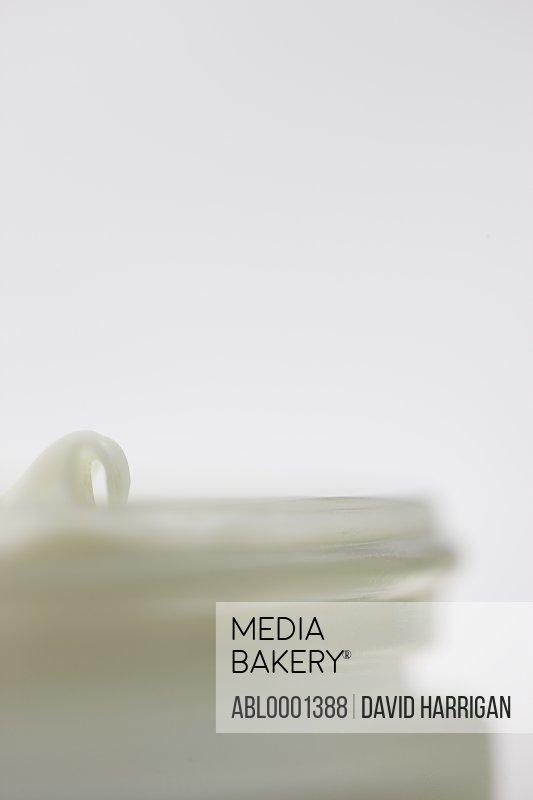 Close up of a jar full of moisturizer