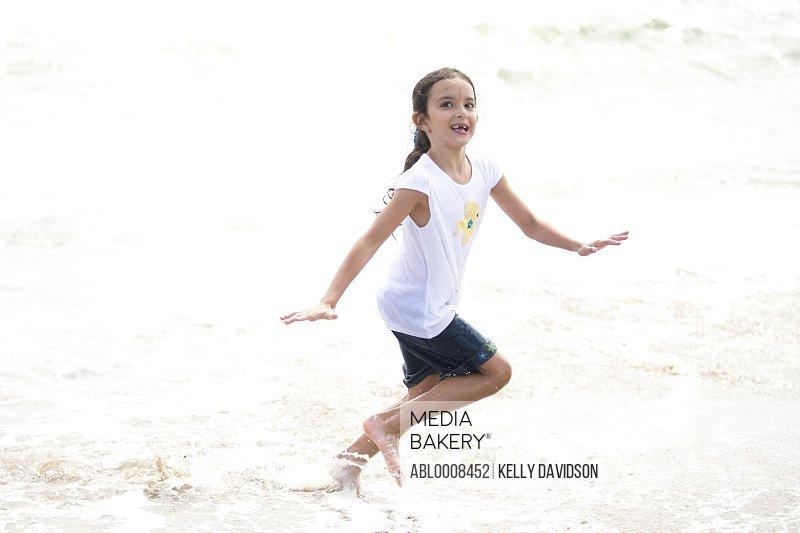Girl Running in Sea Water