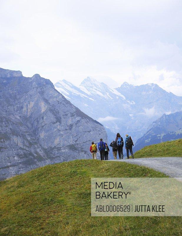 Group of Hikers Descending into Lauterbrunnen Valley