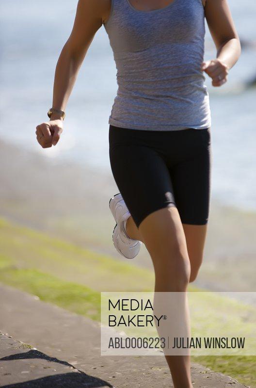 Woman running, headless