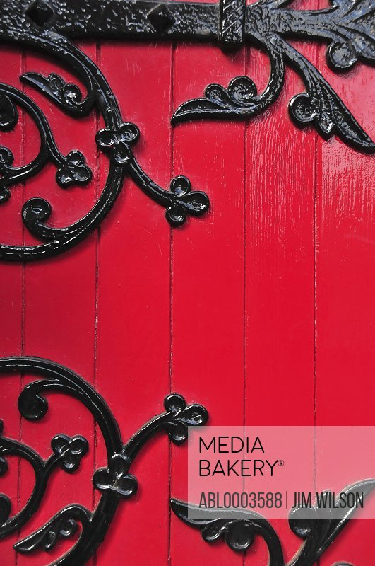 Wrought Iron Decorative Hinges on Red Wooden Door, Full Frame