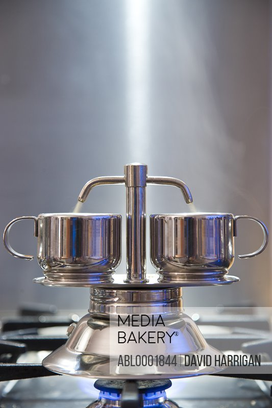 Two cups espresso maker on a stove
