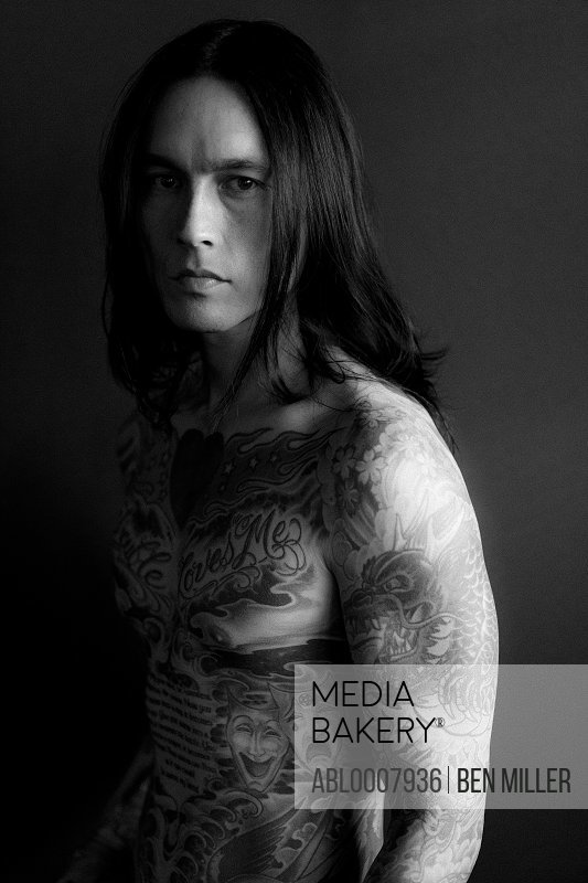 Portrait of Man Covered in Tattoos