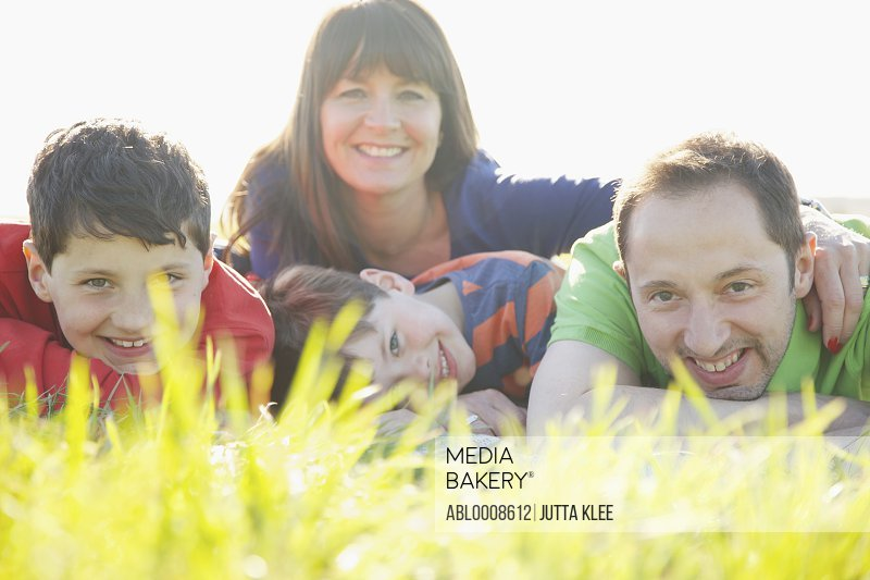 Portrait of Family Lying on Grass