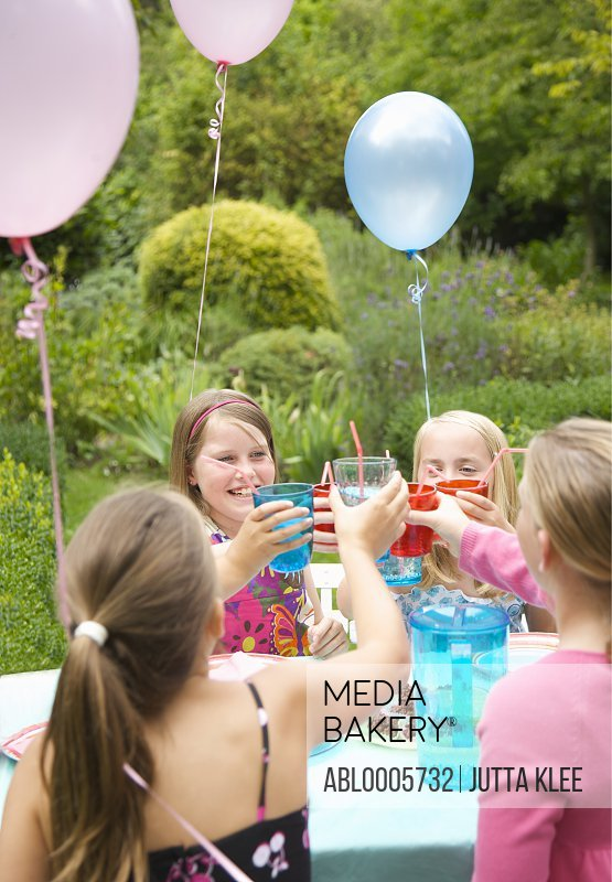Young girls toasting at a garden party