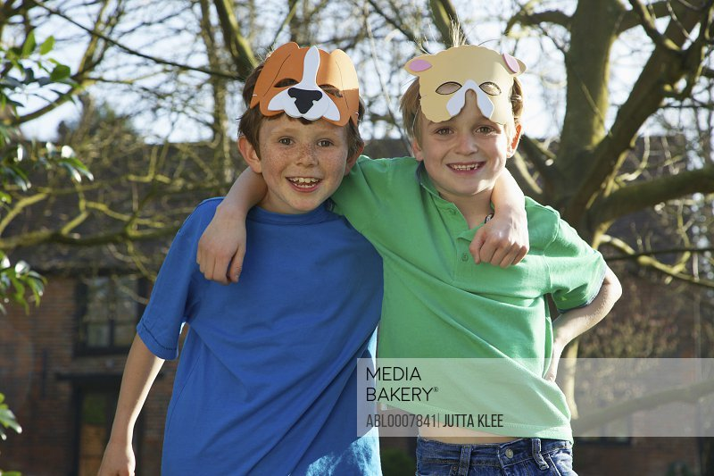 Two Smiling Boys Wearing Animal Masks on Forehead