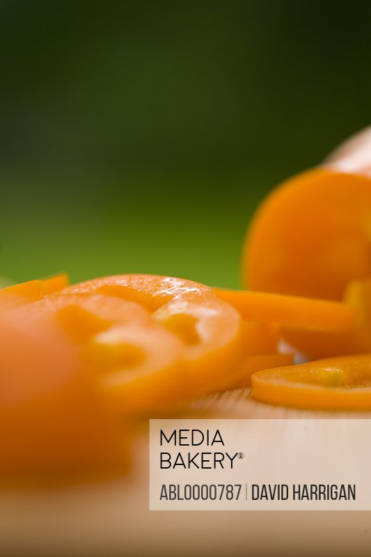 Sliced orange peppers on a chopping board