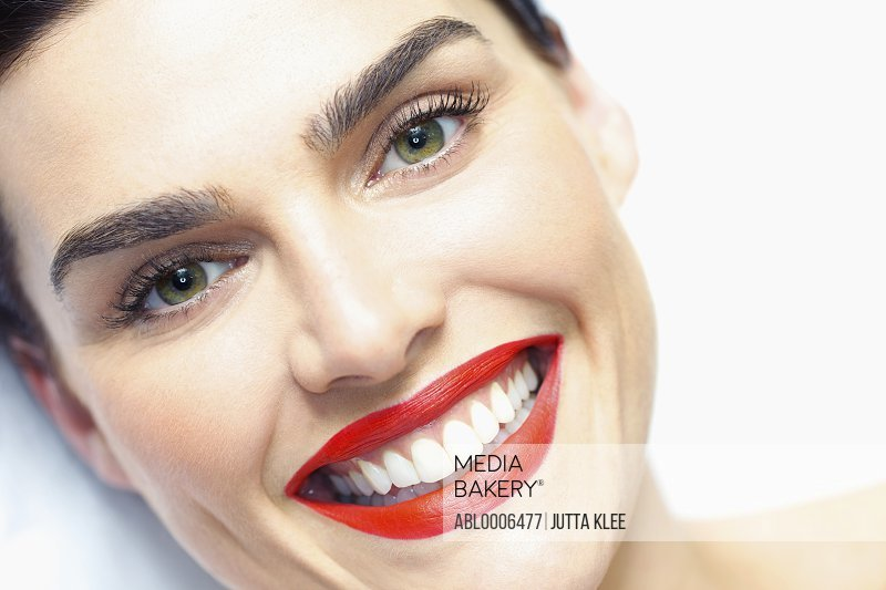 Close up of Smiling Woman's Face with Red Lipstick - High angle view