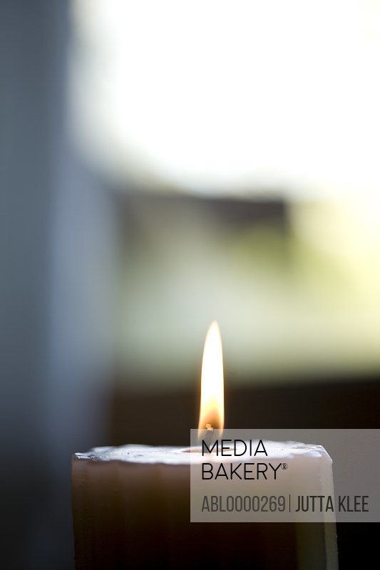 Close up of burning scented candle