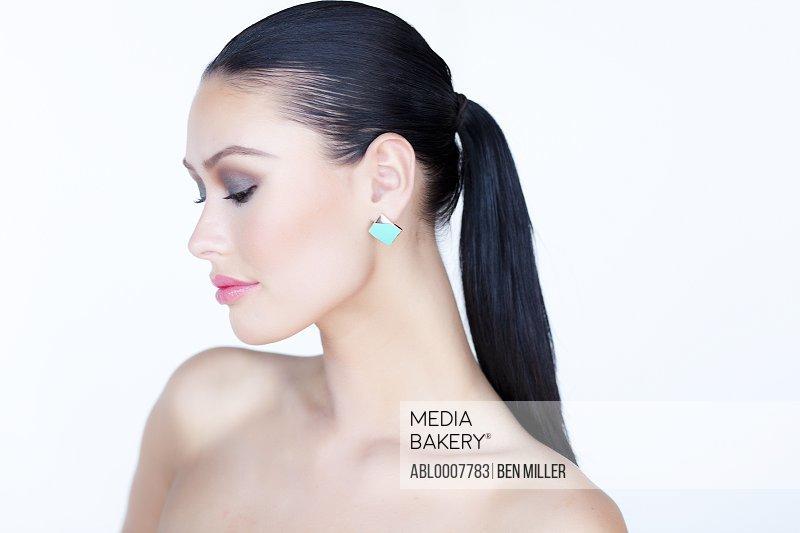 Portrait of Woman Wearing Gold Enamel Earring