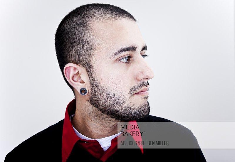 Profile of Man Wearing Ear Gauges