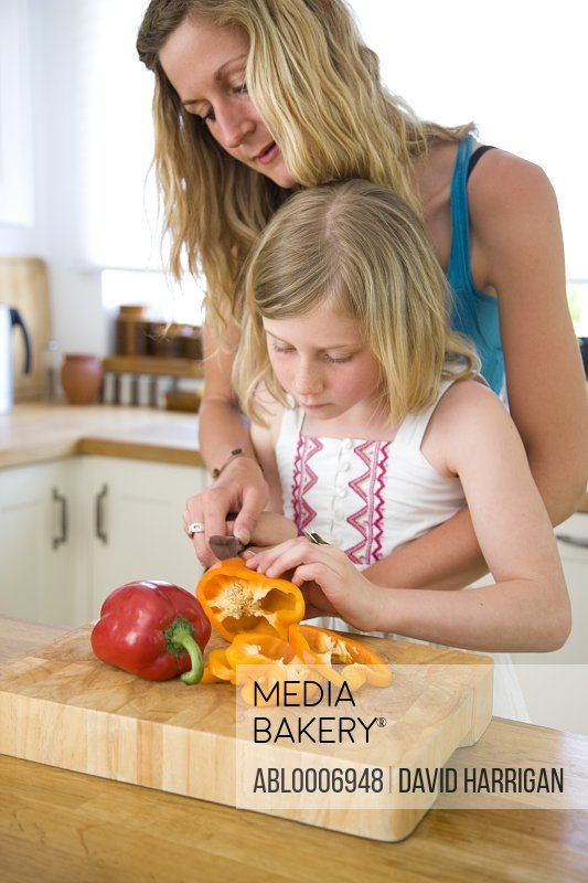 Mother and Daughter Slicing Bell Peppers