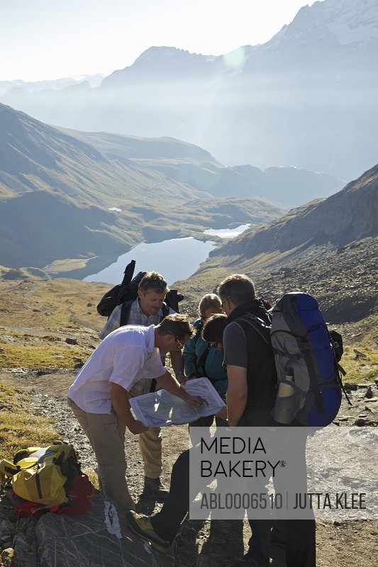 Backpackers Reading Trail Map in Bernese Oberland