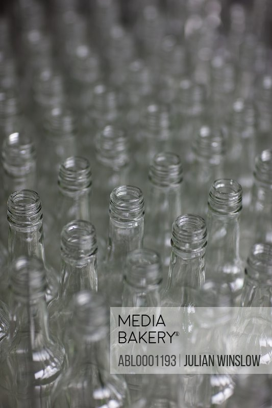 Close up of lined up glass bottles