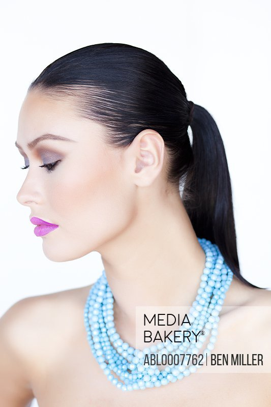 Woman Wearing Purple Lipstick and Turquoise Beads Necklace