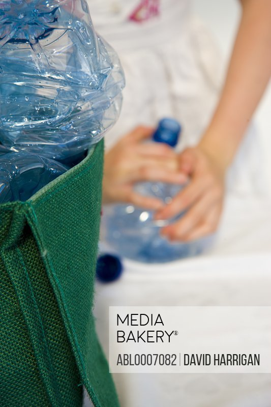 Girl's Hand Crushing Plastic Water Bottles