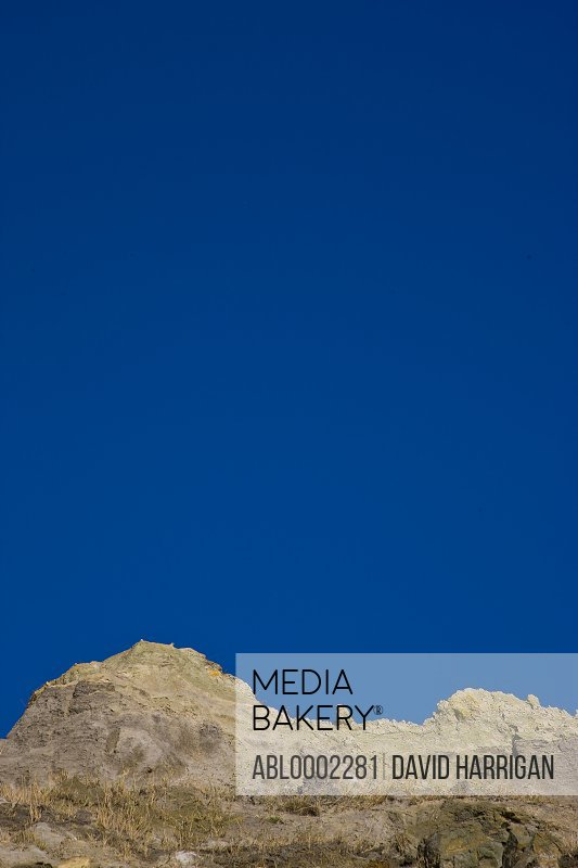 Cliff against Blue Sky - Low angle view