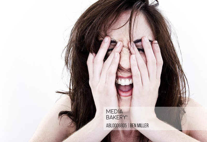 Laughing Woman with Hands on Face