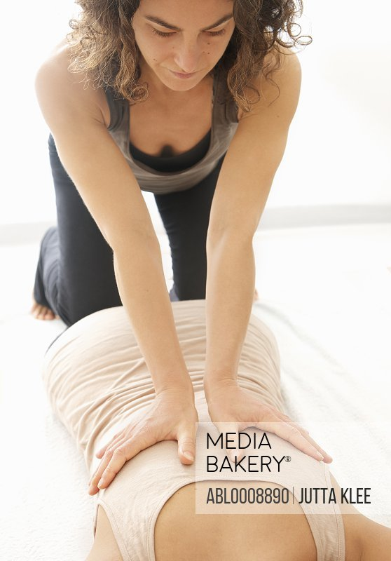Woman Receiving a Thai Yoga Massage