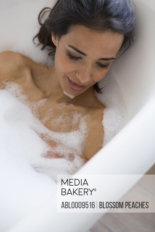 Woman Relaxing in Bubble Bath, Close-up View