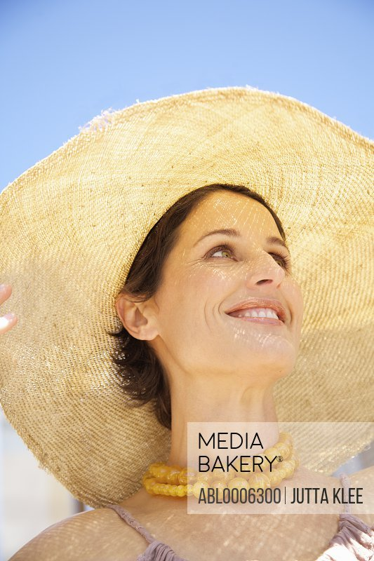 Close up of a woman wearing a straw hat